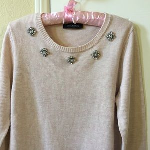 Pink sweater with crystal necklace